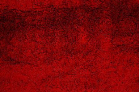 Crimson colored abstract wall background with textures of different shades of crimson and red Stock Photo