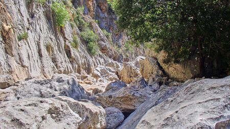 Views of large boulders in a canyon on the Spanish Balearic island of Majorca 스톡 콘텐츠