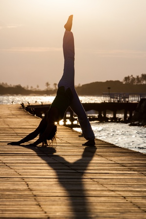 Yoga practise during sunset photo
