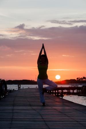 Yoga practise during sunset photo