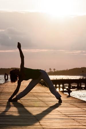 Yoga practice during sunset  photo
