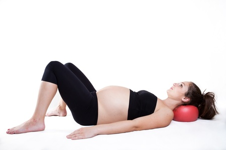 Young pregnant woman is relaxing using overball