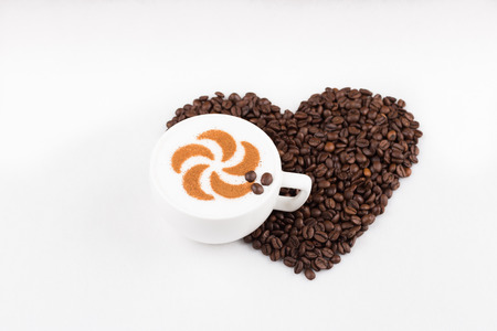 Real capuccino decorated with cinnamon an coffee beans photo