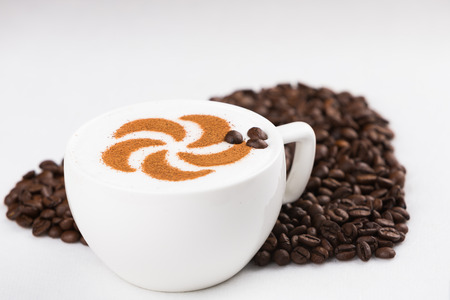 Real capuccino decorated with coffee beans photo