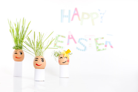 Happy Easter decoration made of  egg-shell faces with hair Stok Fotoğraf