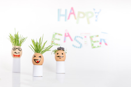 eggshell: Happy Easter decoration made of  egg-shell faces with hair Stock Photo
