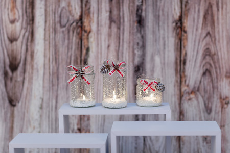 creative homemade christmas candle decoraton in white, silver and red