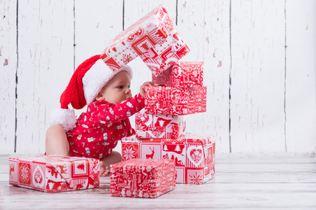 baby in red demolishing the gift tower