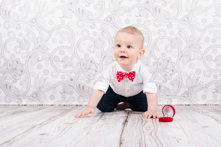 betrothal: Lovely baby boy smilling and pose with betrothal ring Stock Photo