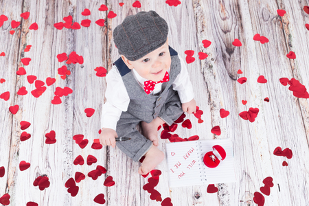 betrothal: lovely baby boy in barret sitting with betrothal ring