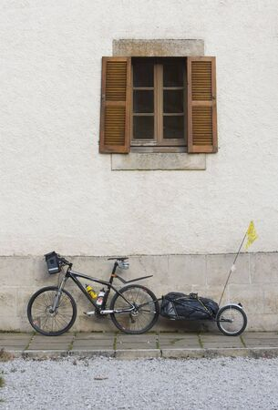 bike of a pilgrim resting in front of a wall