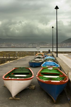 image of some old boats resting in a stormy lead sky Stock Photo - 2770113