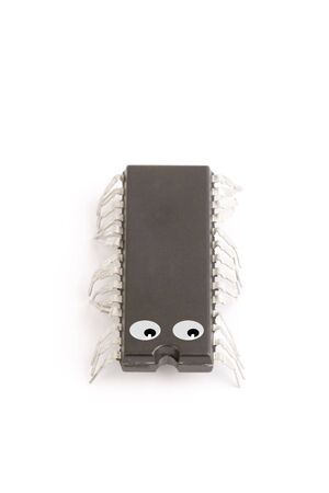 technology isolated computer electronic chip on white background with its pins as legs of a live worm photo