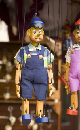 wooden toy puppet marionette string controled pinocchio photo