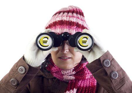 consumerist: christmas woman holding and looking through binoculars Stock Photo