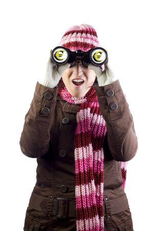 christmas woman holding and looking through binoculars photo