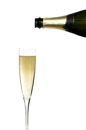 filling a glass cup with champagne wine isolated on withe background photo