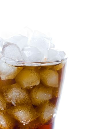 cola soft drink in a glass full of ice cubes photo