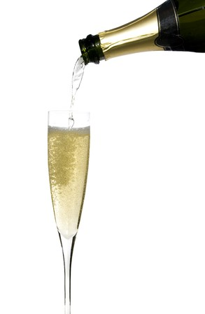 withe background: filling a glass cup with champagne wine isolated on withe background Stock Photo