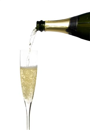 champagne flute: filling a glass cup with champagne wine isolated on withe background Stock Photo
