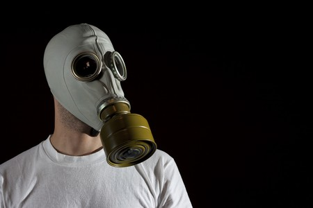 a man wearing a gas mask environment danger concept image Stock Photo - 4070847
