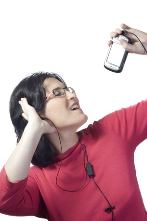 young woman listening, dancing and singing to music in a mp3 device photo
