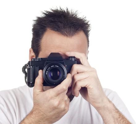un fotografo con una macchina fotografica d'epoca analogica isolata su sfondo withe Archivio Fotografico
