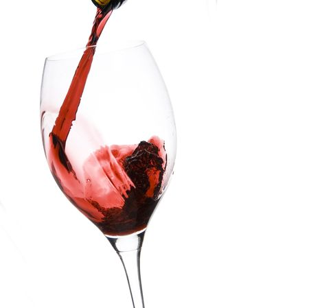 red taste: a clear glass of red wine isolated on white background