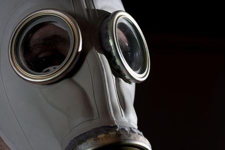 a man wearing a gas mask environment danger concept image photo