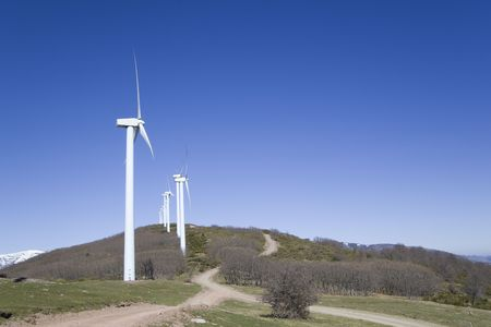 wind turbines renewable power over a blue sky  Stock Photo - 5741232
