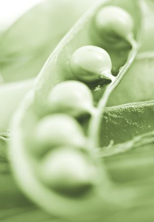 peas in the sheath with a narrow depth of field photo