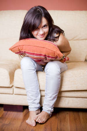beautiful girl portrait sitting in the sofa of a living room photo