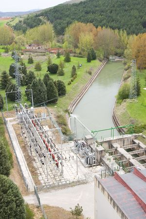 image of  a dam generating electricity with rushing water photo