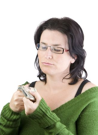 green sweater woman holding dollar banknotes thinking in spending or investing money  photo
