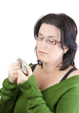 green sweater woman holding dollar banknotes thinking in spending or investing money  Stock Photo - 6267681