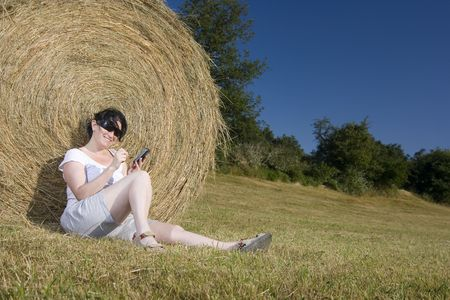 young woman resting on the grass photo