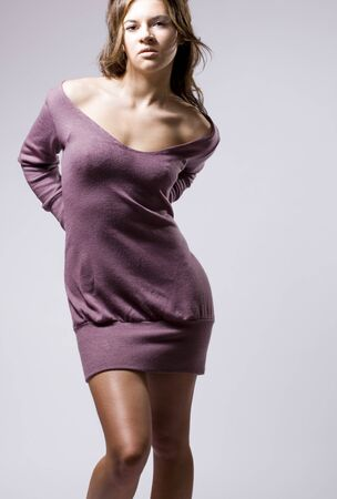 brunete: real young beautiful girl posing over a grey background