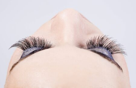 detail of the make up of eyelashes in a young beautiful girl
