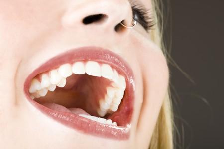 口: 笑顔と笑い、若いきれいな女の子の口 写真素材