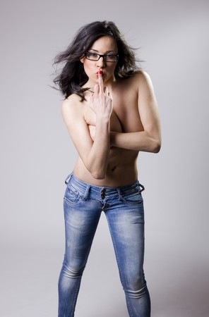 a rude nude young girl showing her middle finger Stock Photo - 7223386