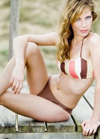 gorgeous sensual young girl with a bikini swimwear in a fashion shot photo