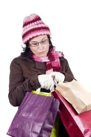 Consumerist Christmas girl with bags in a shopping day photo