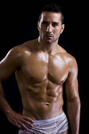 desnudo masculino: saludable chico atractivo mostrando su torso fuerte y ajustar  Foto de archivo