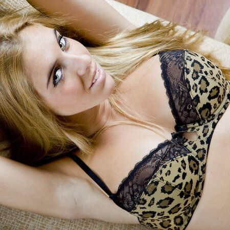 sexy young blond girl laying on a sofa in lingerie Stock Photo - 7419308