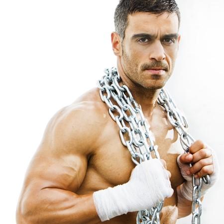 culturista: hombre grosero sexy en un fondo de grunge  Foto de archivo