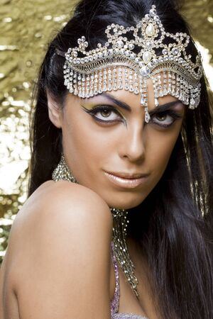 portrait of a beautiful oriental dancer with a tipical egyptian make up photo