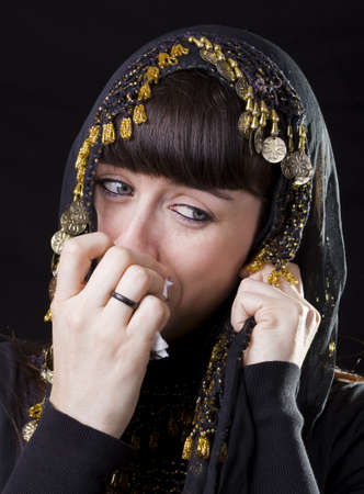 teary: caucasian young girl with a veil crying and using a tissue