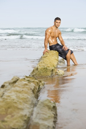 sexy caucasian fit man posing in a beach Stock Photo - 8875534