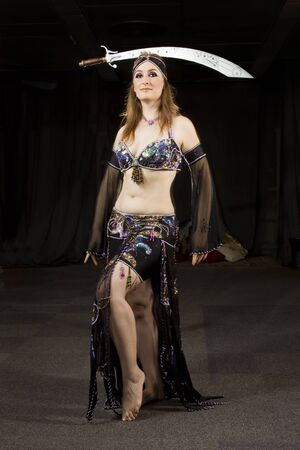 beautiful woman dancing the oriental style dance called belly dance photo