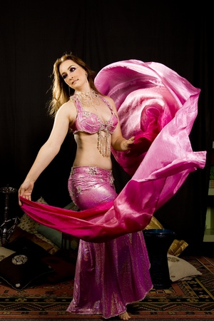 beautiful woman dancing the oriental style dance called belly dance Stock Photo - 9176951